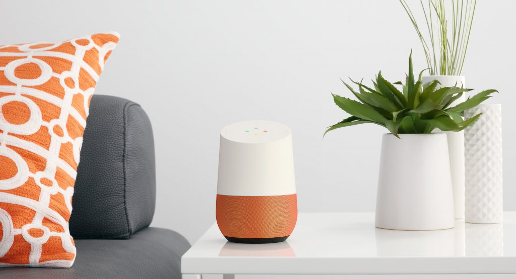 A Google Home device on a living room table.