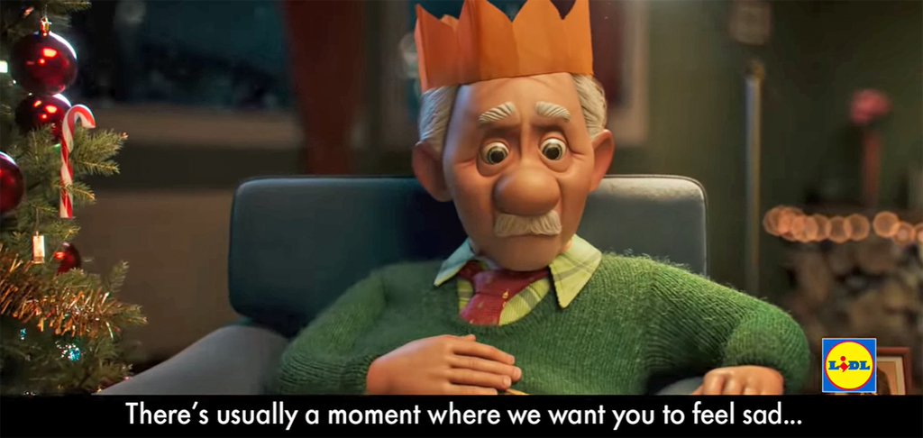 image shows an animated image of an elderly man looking sad and wearing a Christmas party hat